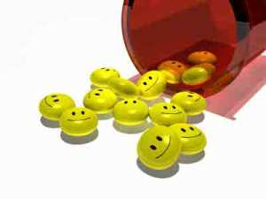 yellow pills with happy faces coming out of red container